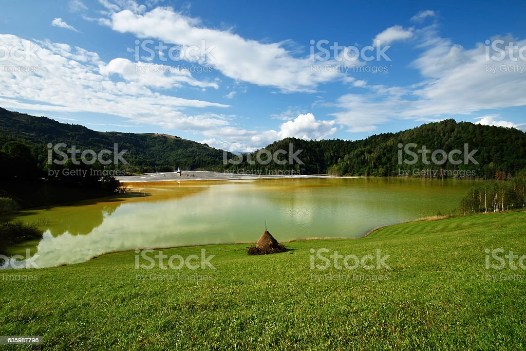flooded church in toxic red polluted lake stock photo