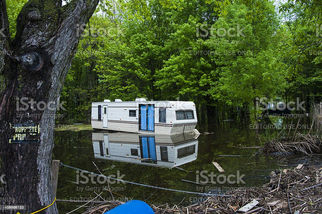 Flooded deserted mobile home. royalty-free stock photo