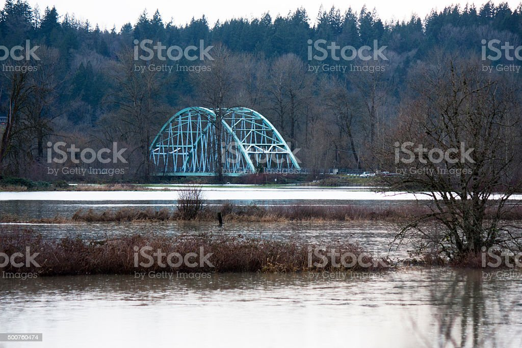 Flooded Fields and the Novelty Bridge stock photo