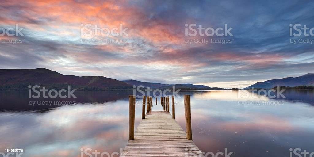Flooded jetty in Derwent Water, Lake District, England at sunset royalty-free stock photo