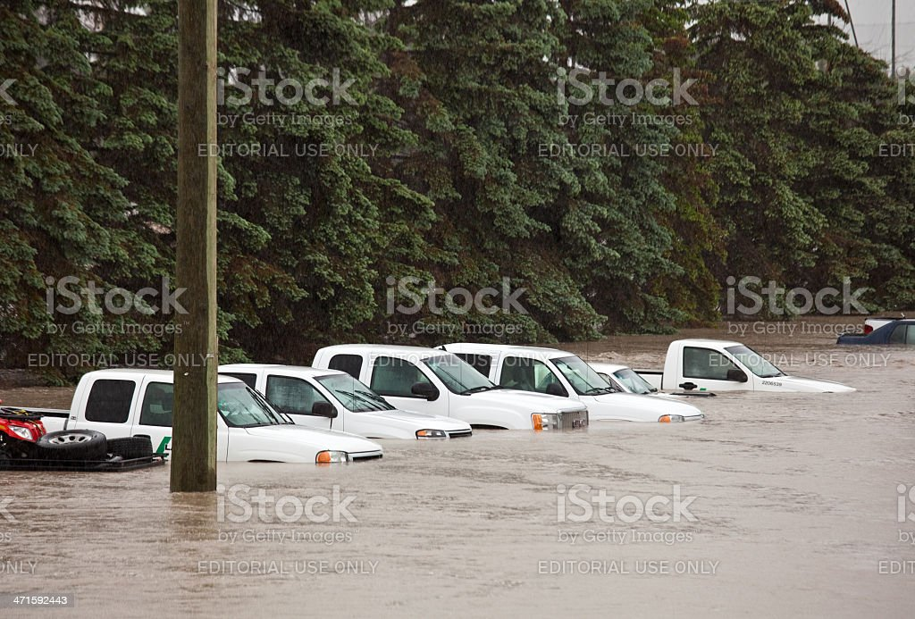 Flooded Parking Lot and Damaged Vehicles stock photo