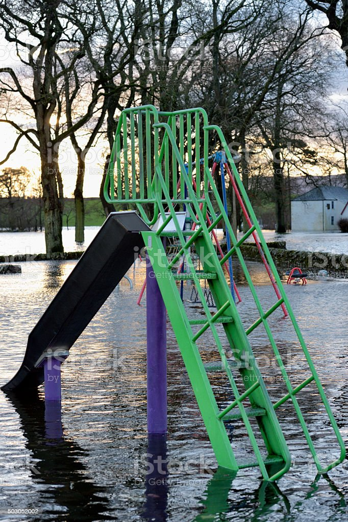 Flooded play area in Scottish park stock photo