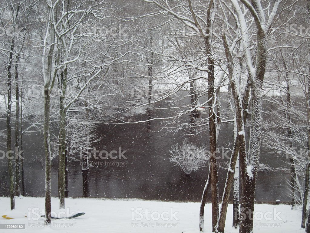 Flooded River in the Snow stock photo