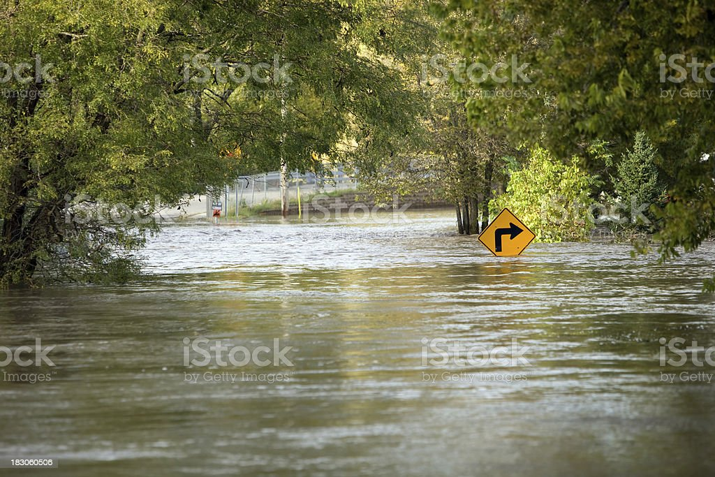 Flooded River Over a City Street stock photo