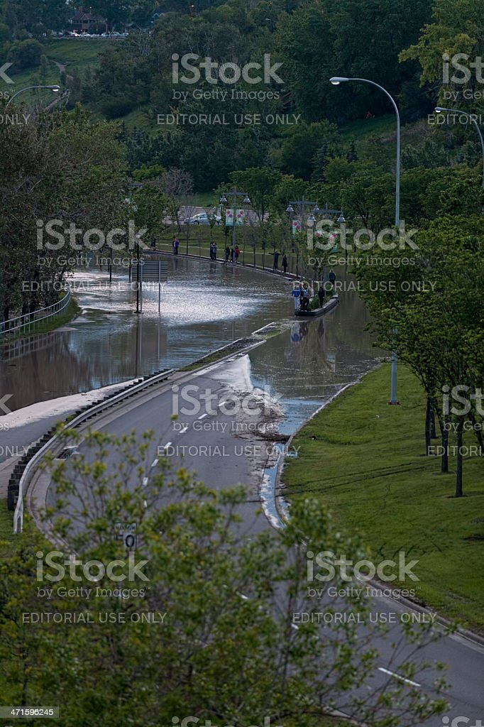 Flooded road along the Bow River in Calgary royalty-free stock photo
