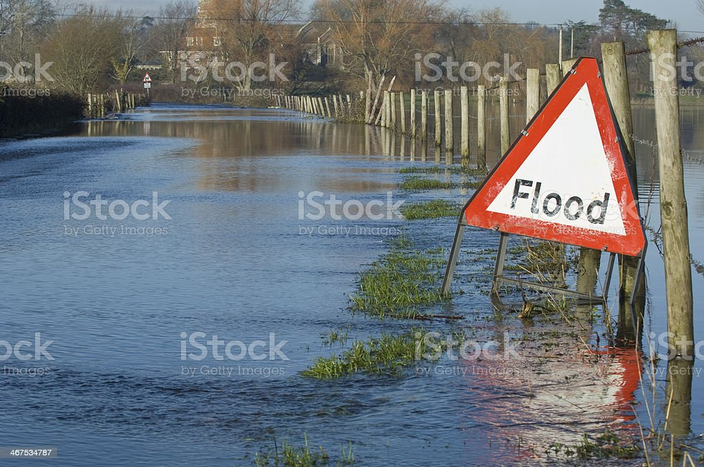 Flooded road and fields stock photo