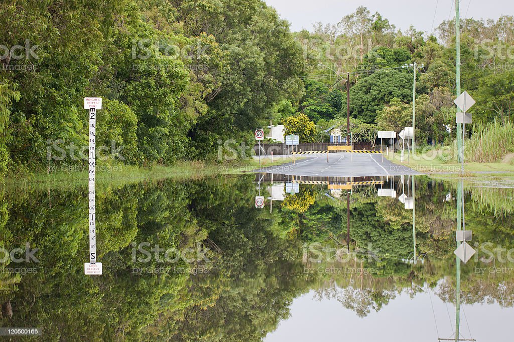 Flooded road with depth indicators stock photo