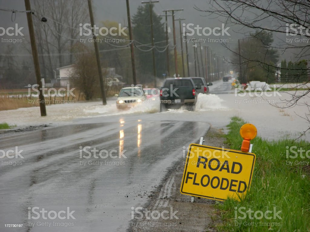 Flooded Road with Sign stock photo