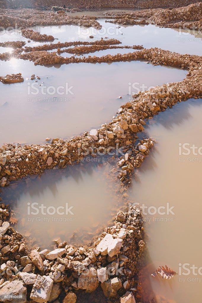 Flooded rocky land stock photo