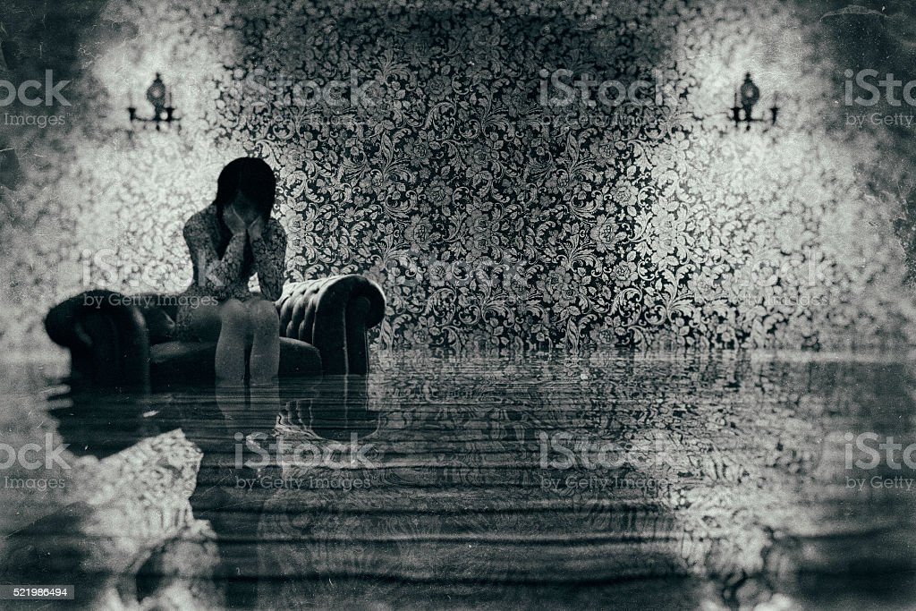 Flooded room with flower pattern wallpaper stock photo