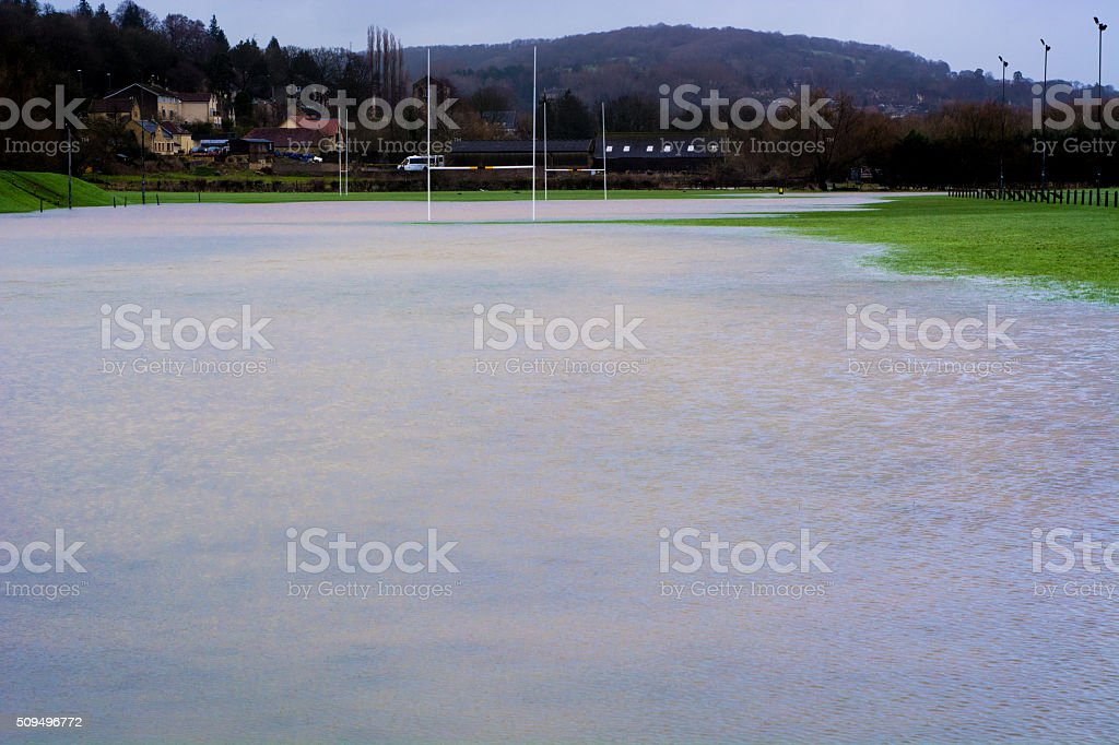 Flooded rugby pitch with standing water stock photo