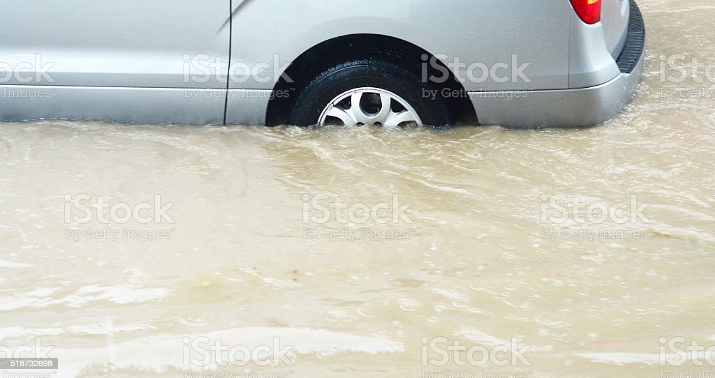 flooded street with vehicle stock photo