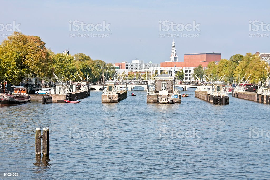 Floodgates in the Amstel Amsterdam Netherlands royalty-free stock photo