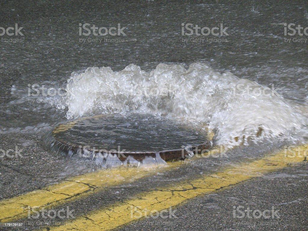Flooding Manhole Cover stock photo