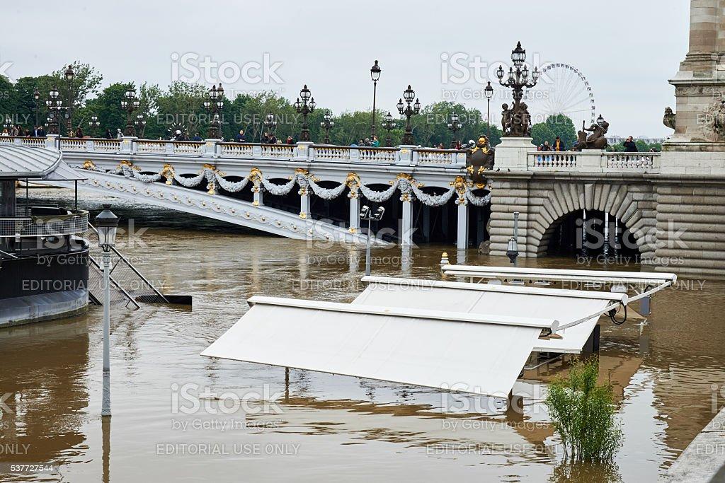 Flooding river Seine near bridge of Alexandre III royalty-free stock photo