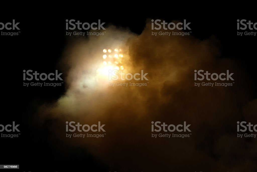 floodlight behind smoke from petard during soccer game stock photo