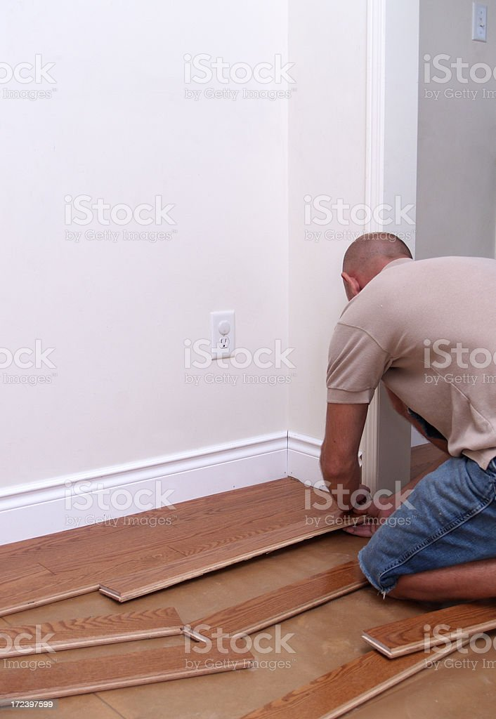 Floor installation, contractor installing oak floors royalty-free stock photo