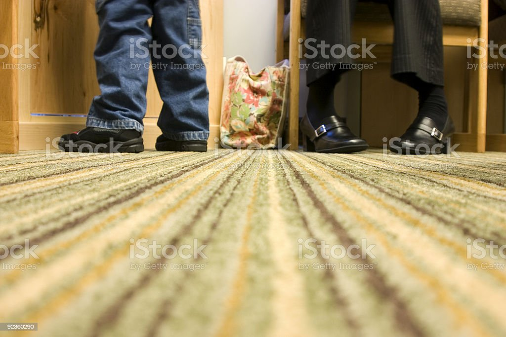Floor Level Shot of Mom and Son at a Doctor's office royalty-free stock photo