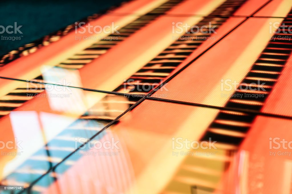LED floor technology with orange and yellow pattern stock photo