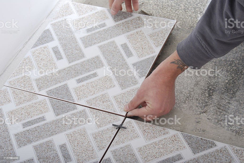 Floor tiles installation royalty-free stock photo