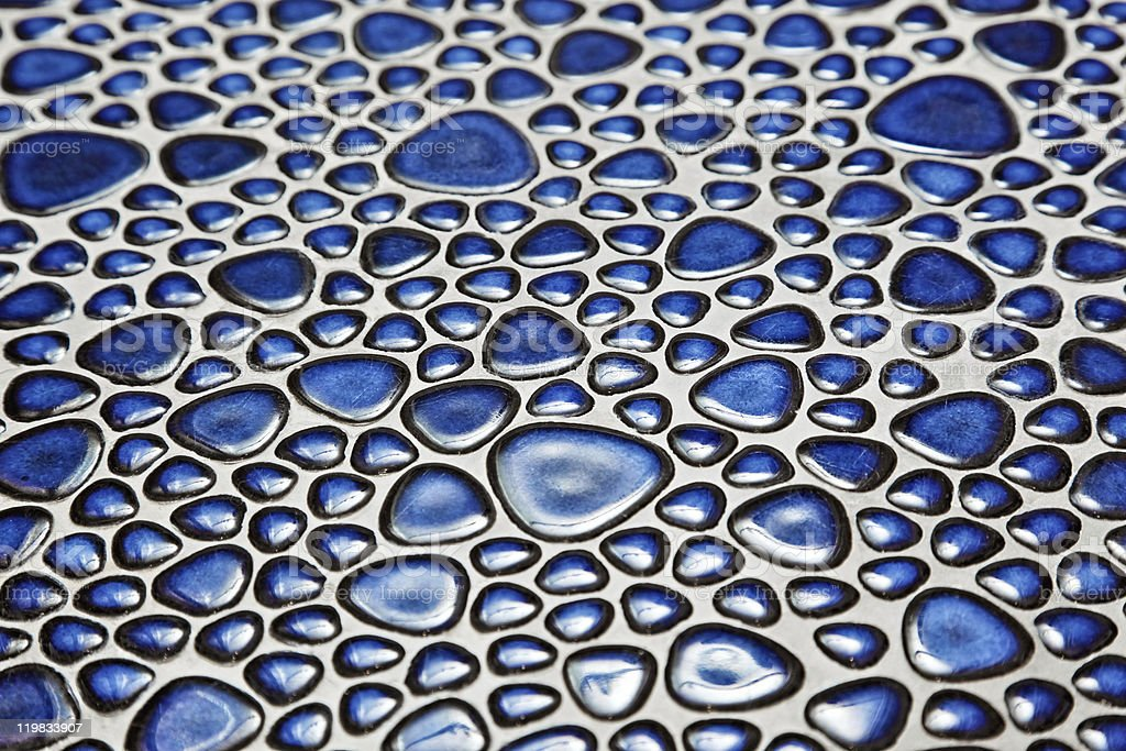 Floor with blue pebble mosaic pattern royalty-free stock photo