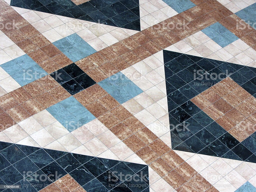 Flooring covered with colorful marble, granite and ceramic tiles royalty-free stock photo