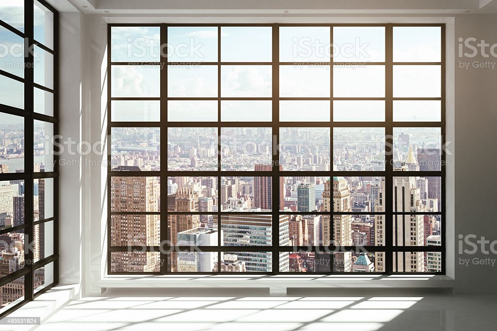 Floor-to-ceiling windows with city view stock photo