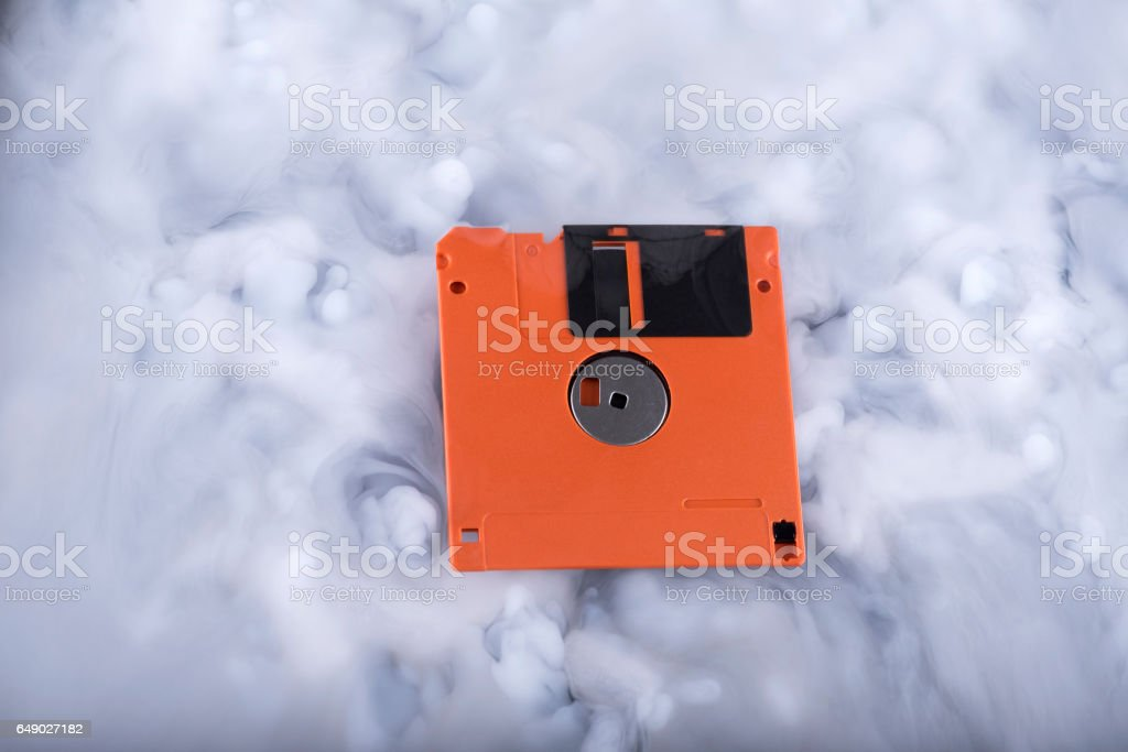 Floppy disk in a clouds stock photo