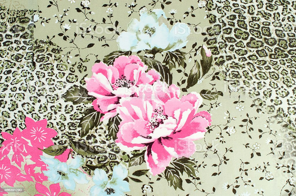 Floral and cheetah pattern on fabric. stock photo