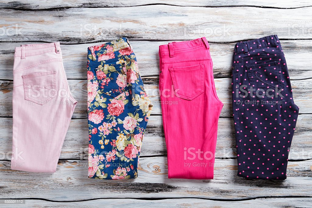 Floral and pink folded pants. stock photo