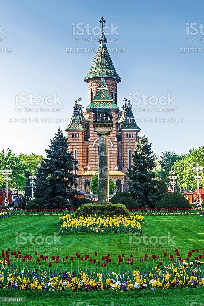 Floral arrangements in Victory Square, with orthodox cathedral stock photo