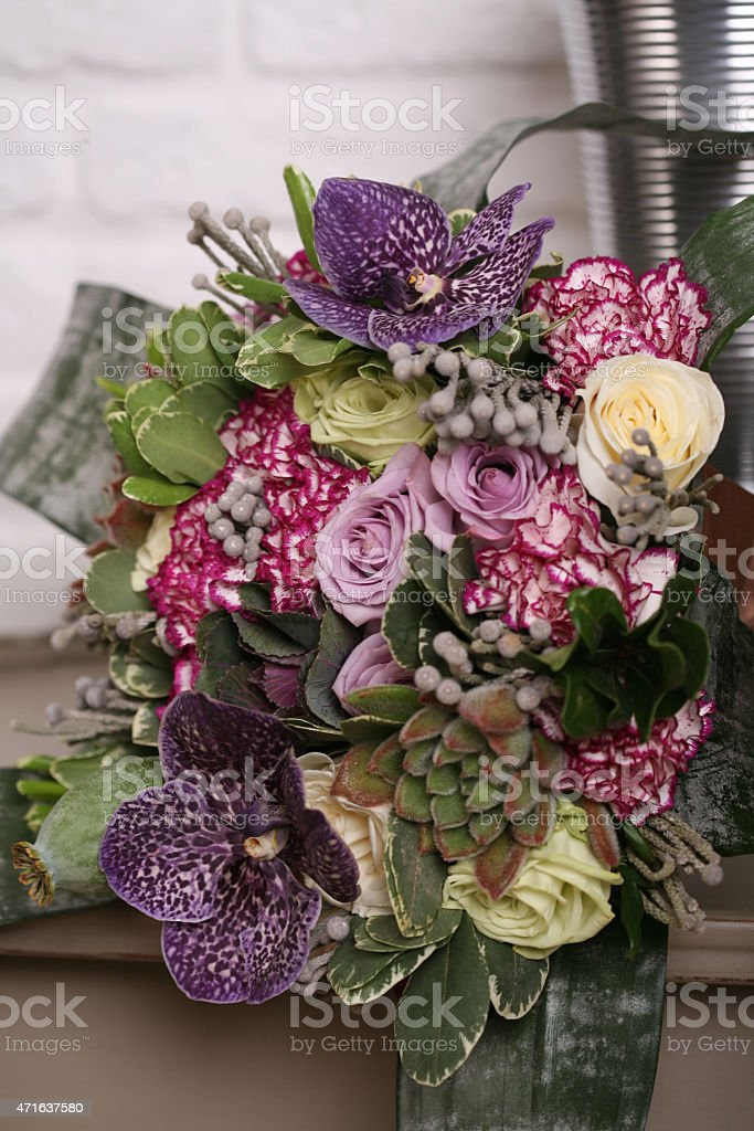 Floral bouquet of orchid Vanda, roses, carnations, leaves pittosporuma and stock photo