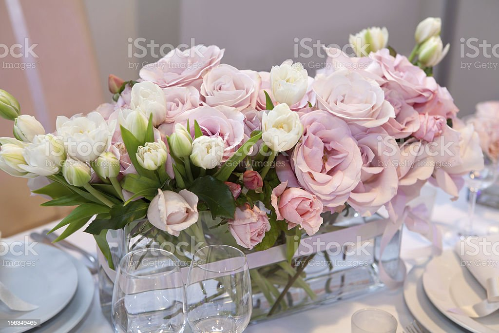 Floral center piece at a wedding dinner stock photo