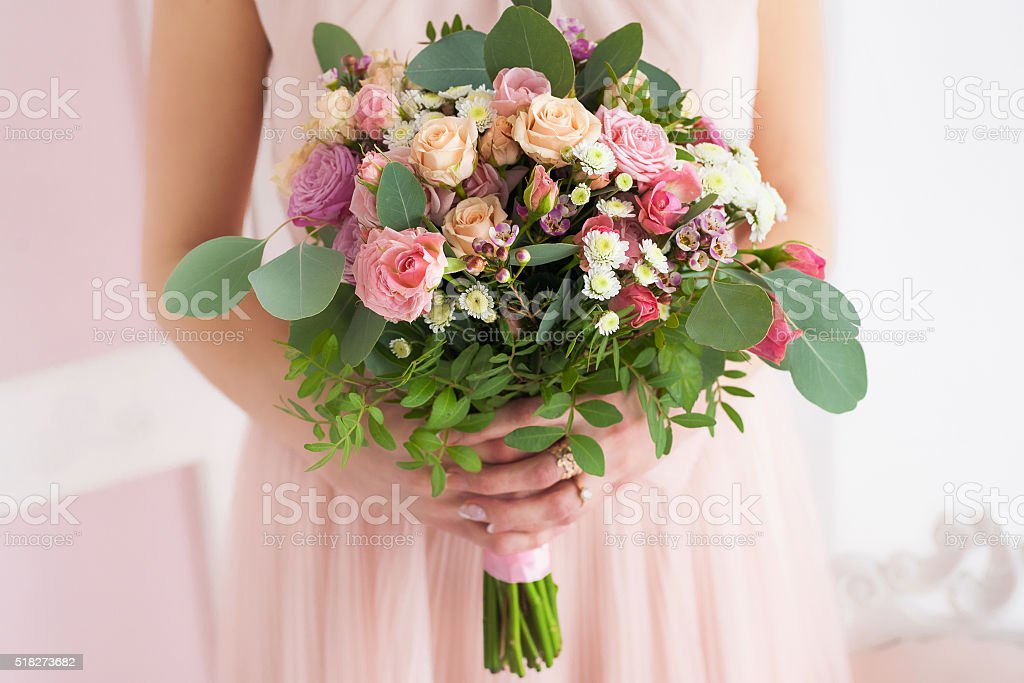 floral composition in hands of young girl stock photo