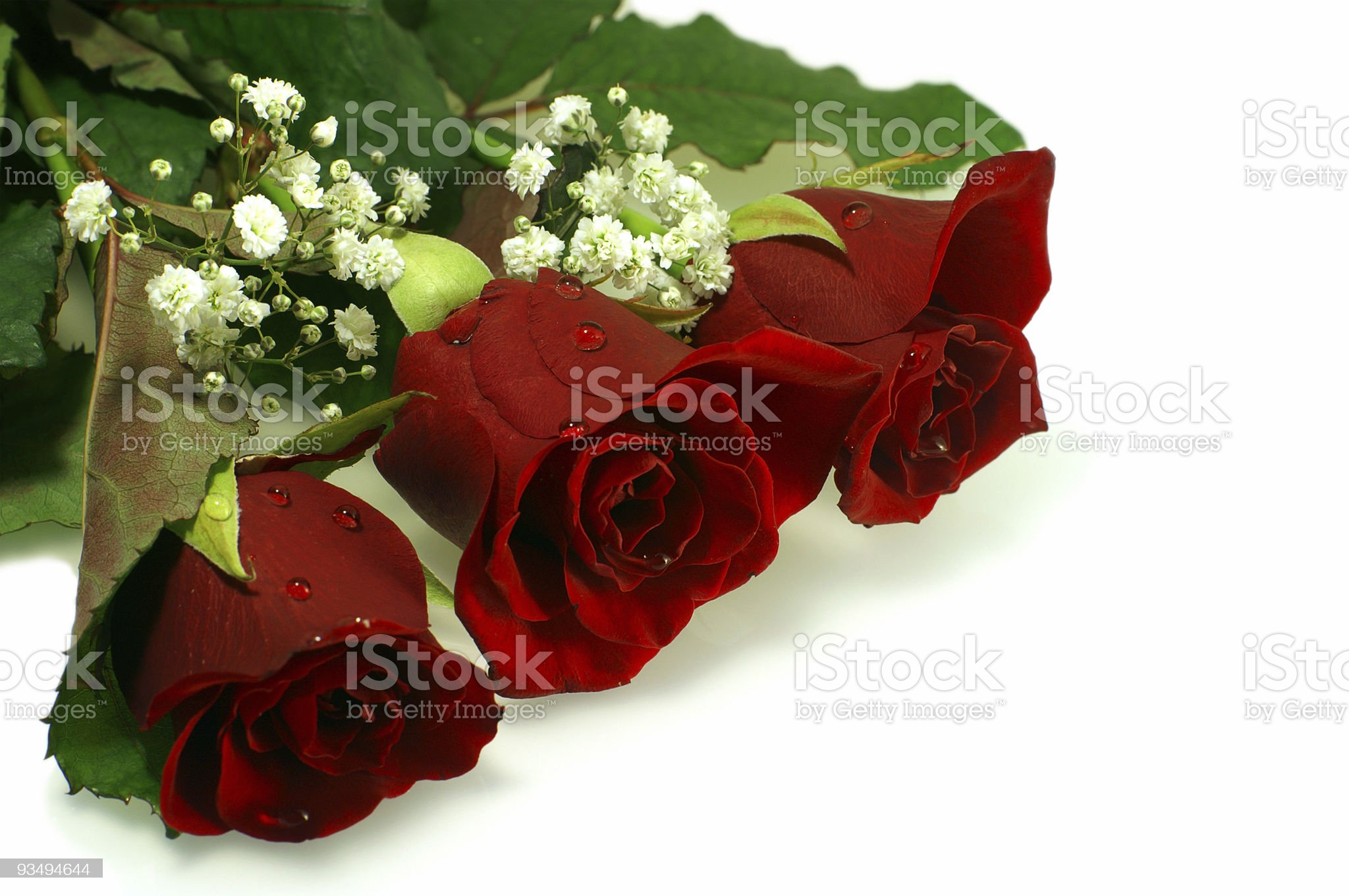 floral composition with three nice red roses royalty-free stock photo