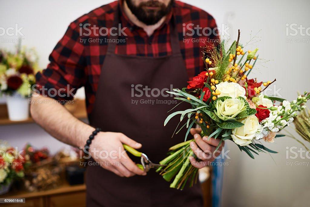 Floral designer arranging elegant flower bouquet stock photo