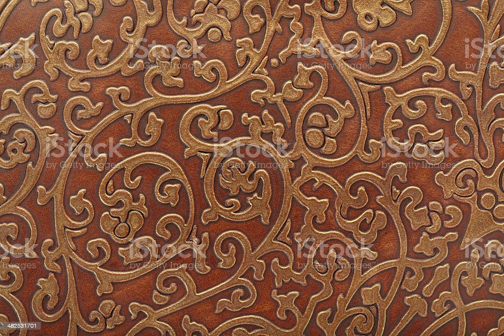 Floral pattern in brown leather stock photo