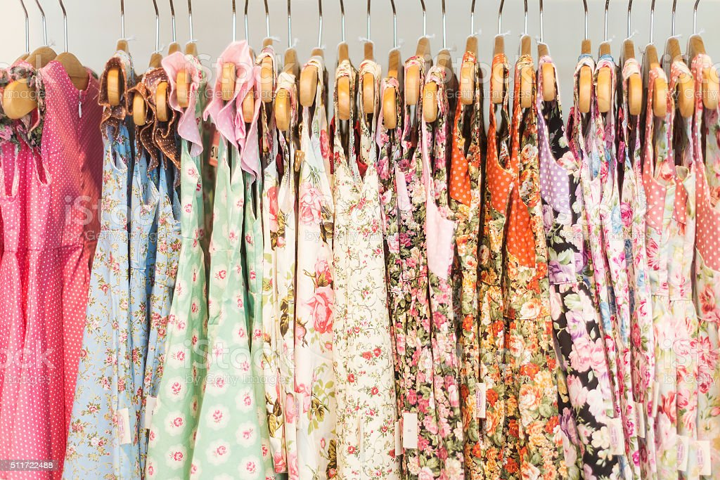 floral pattern young girl dresses in shop stock photo
