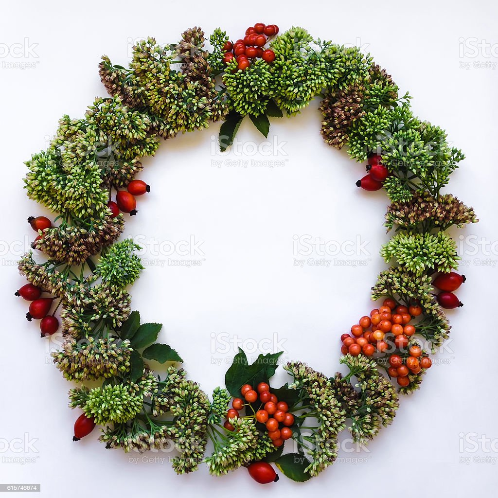 Floral round wreath. Flat lay, top view. Autumn, winter decoration stock photo