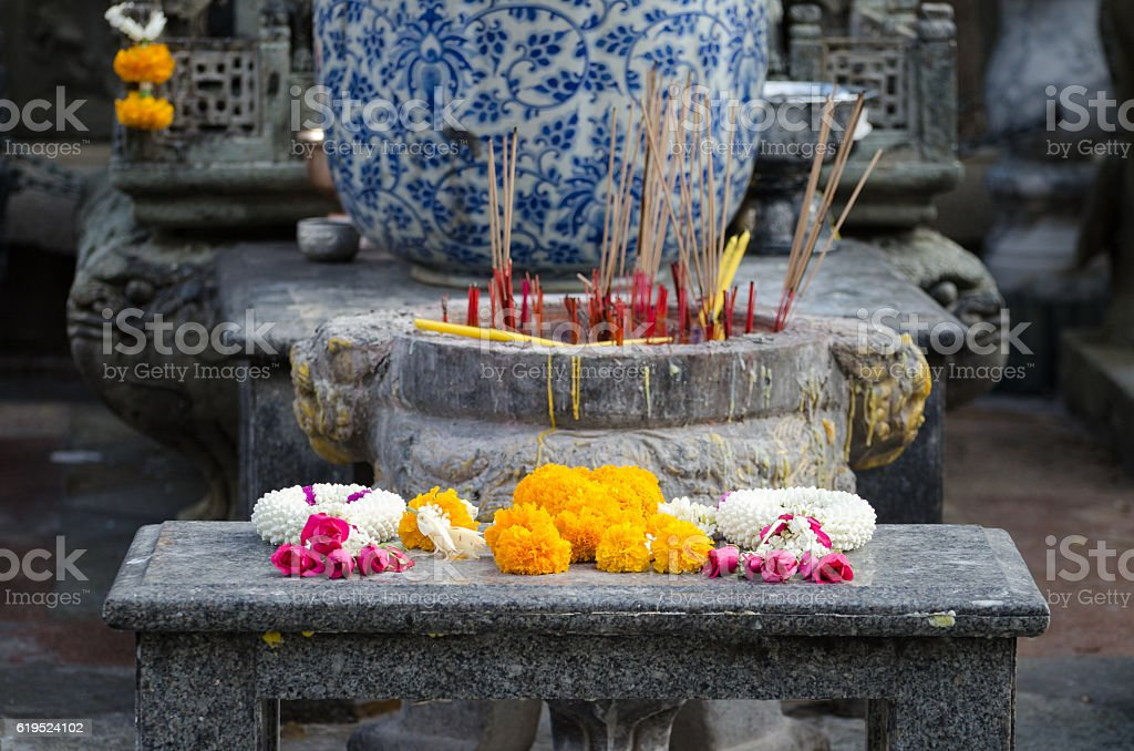 Floreals offers in a buddhist temple (Bangkok) stock photo