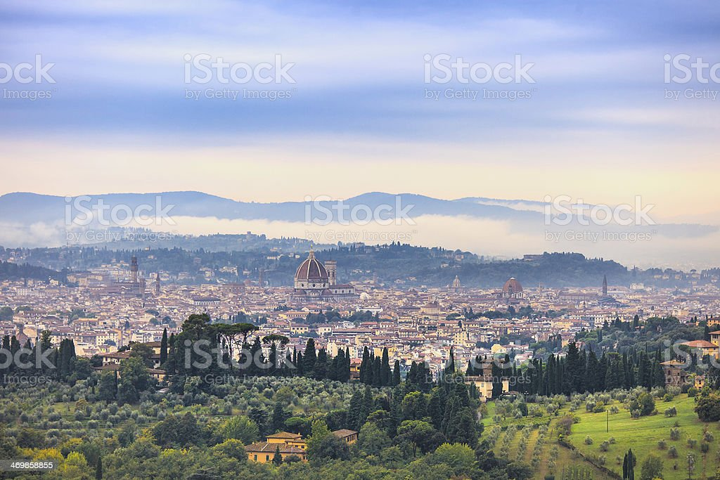 Florence aerial foggy morning cityscape. Panorama view from Fiesole, Italy stock photo