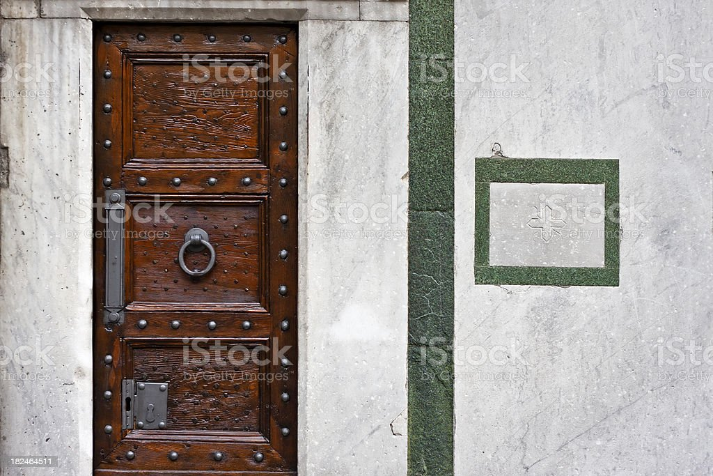 Florence Baptistery Marbles with Closed Door, Italy stock photo
