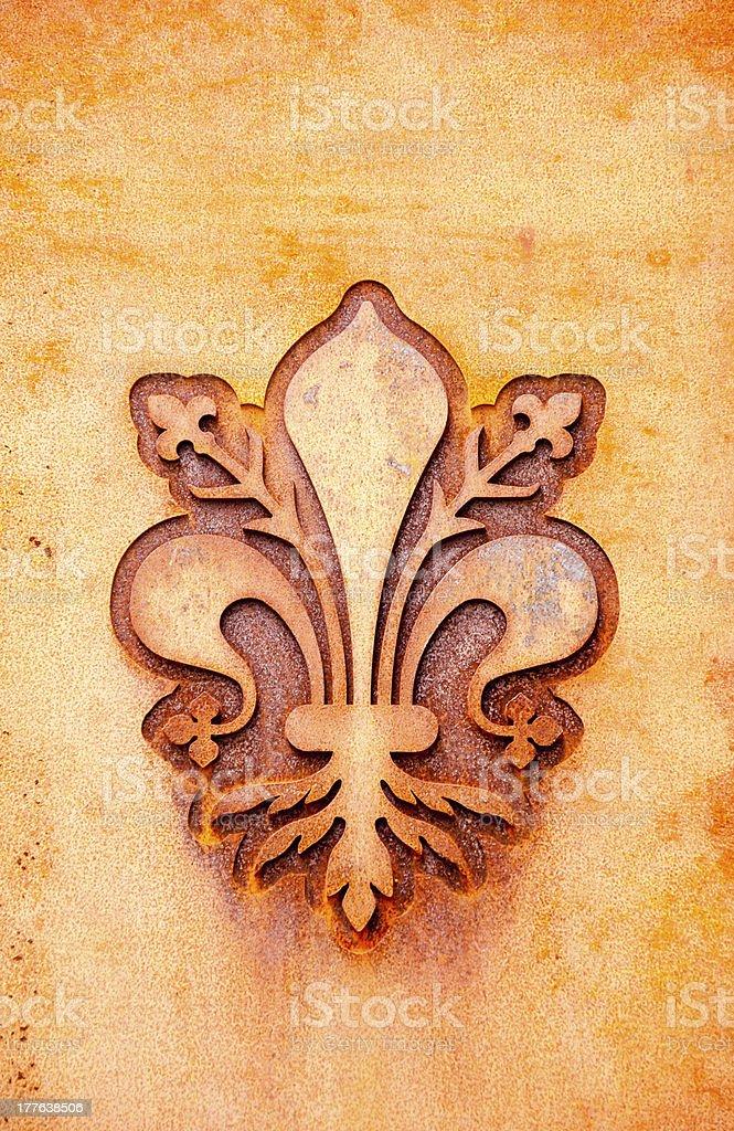 florence fleur-de-lis symbol on a rusty metal plate stock photo