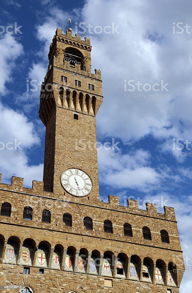 Florence Historic clock tower building in the main city square stock photo