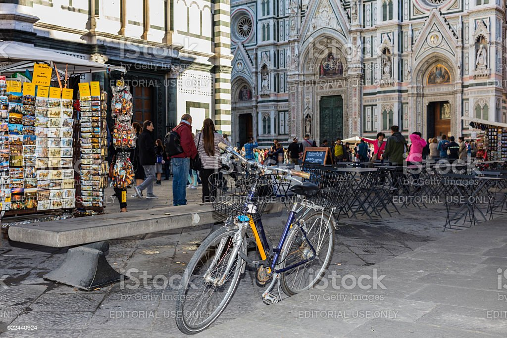 Florence, Italy. Bycicle and tourists in Piazza del Duomo stock photo
