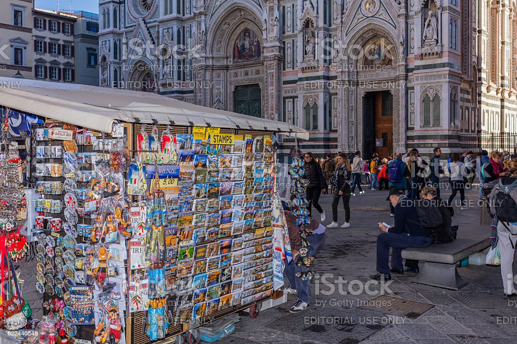 Florence, Italy. In Piazza del Duomo, tourists and souvenir seller stock photo