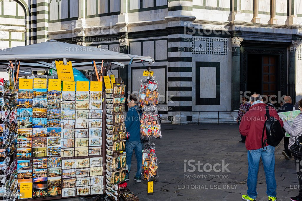 Florence, Italy. Piazza del Duomo with tourists and souvenir seller stock photo