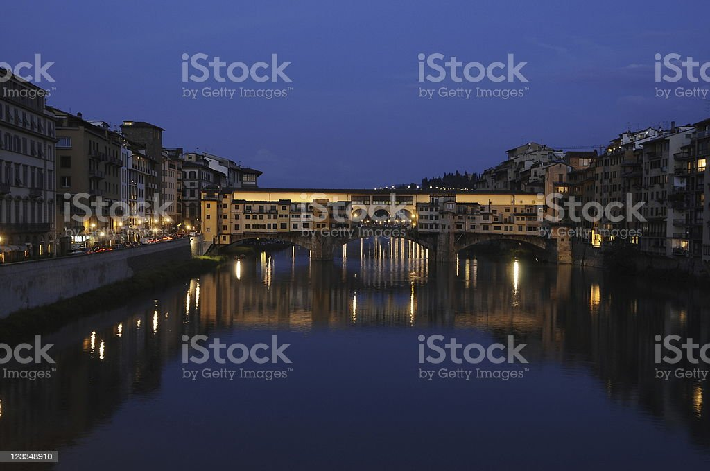 Florence, Ponte Vecchio reflection, River Arno, at night stock photo