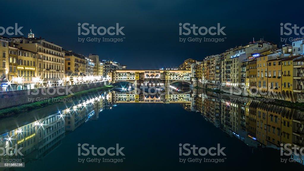 florence vecchio bridge at night stock photo