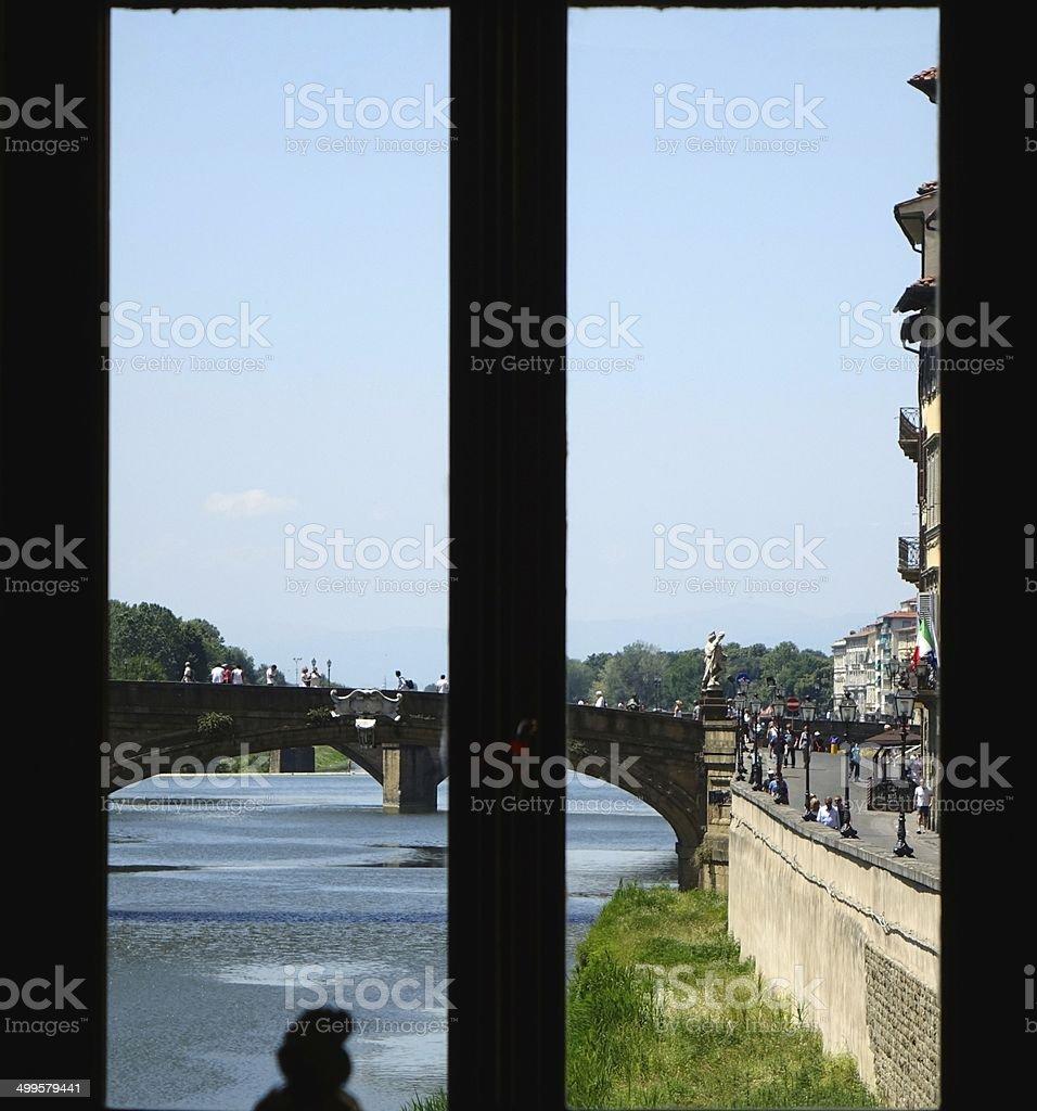 Florence via a window of the Ponte Vecchio stock photo
